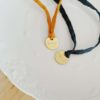 bijou porte bonheur bracelet soie habotai grigri medaille doree or fin bijoux precieux