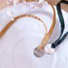 Bracelet porte bonheur soie habotai médaille amour argentée fait à la main dans l'île de ré made in france creation artisanale française gros plan